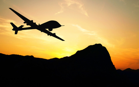 military silhouettes: Drone flying over mountains on sunset background. Illustration