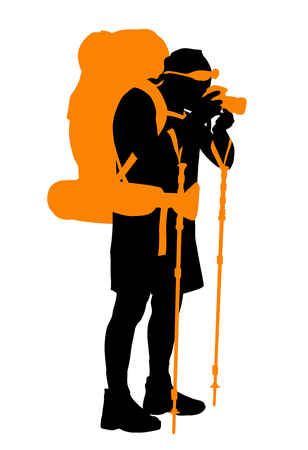 Backpacker with camera taking photo silhouette.
