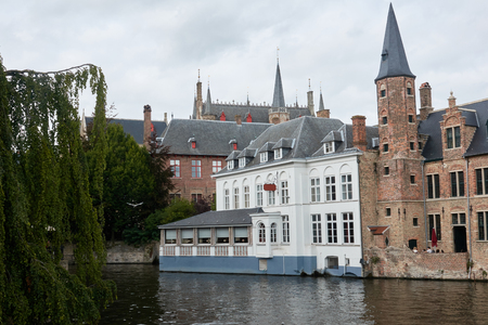 Medieval castle on the water in the tourist town of Bruges.