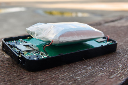 Swollen phone lithium battery. A reason for an explosion of a smartphone.