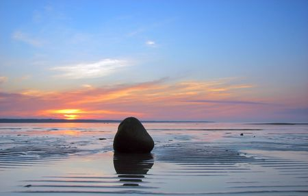 ebb: lines and stone on the sand and beautiful sunset