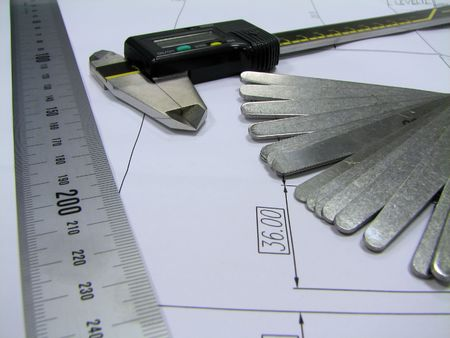 thickness: Engineer elements : Thickness Gauge, Digital calliper and metal ruler.