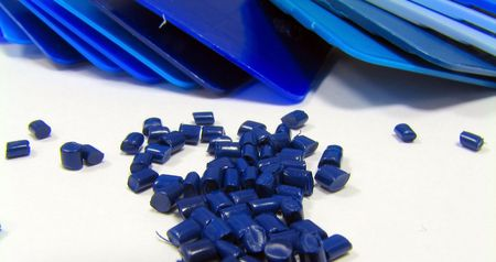 blue masterbatch and blue plastic samples on white Stock Photo