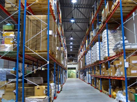 work material: warehouse with shelves of stock.  Stock Photo
