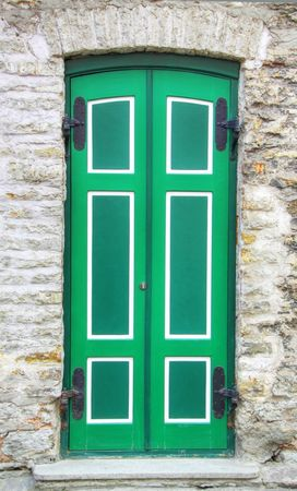 view of a wooden doorway: Old green wooden door