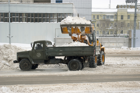 Cleaning snow from city streets. Orenburg, Russia. 07.02.2009