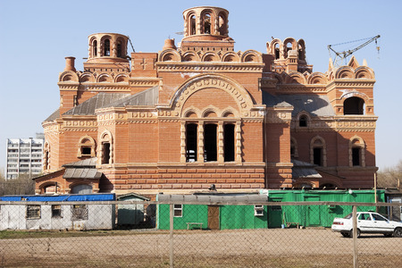 chainlink fence: Construction of the temple complex in honor of Our Lady of Kazan, Orenburg. Russia. 06.05.2009 Editorial
