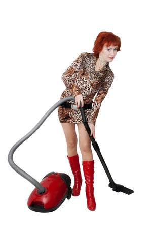 Girl with a vacuum cleaner. White background, isolation