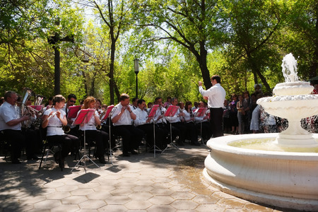 In the city park plays a brass band. Orenburg, Russia. 09.05.2010 Editorial