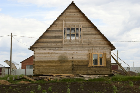 Unfinished wooden house with a backyard Stock Photo