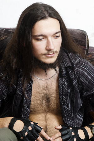 leathern: Long haired man with a hairy chest in the chair