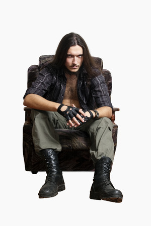 Grim-haired man sitting in a chair