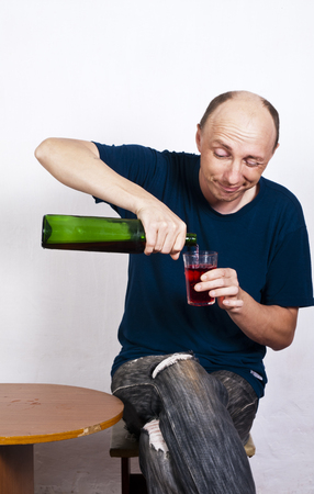spirituous beverages: Drunk man pouring wine in a glass Stock Photo