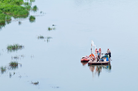 Tourists are fused along the Ural River on a raft. Russia. 30.06.2012