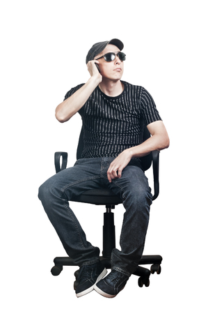 Man talking on cell phone while sitting in an office chair