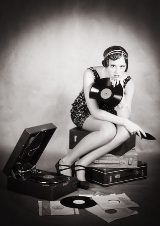Girl with gramophone and a broken plate. Retro