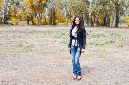 Girl in a park in autumn photo