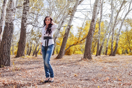 Girl in a city park in autumn photo