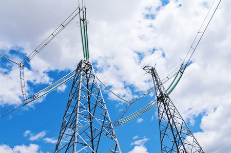 wire: Power transmission supports against cloudy sky Stock Photo
