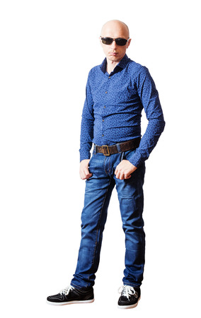 leathern: Skinhead man in sunglasses, shirt and blue jeans