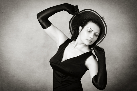 Dancing woman in hat and evening dress Stock Photo