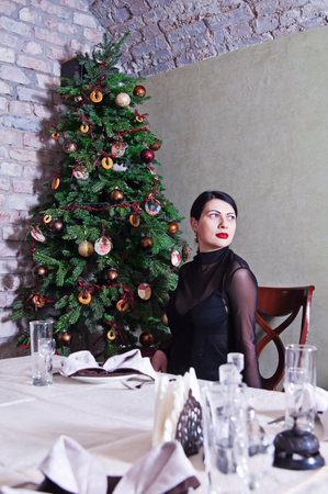 Girl at a restaurant table in the New Year Stock Photo
