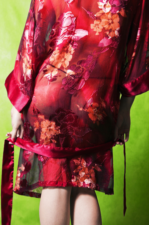 negligee: Girl in red transparent negligee Stock Photo