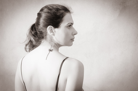 Portrait of a dark-haired woman in profile