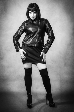Brunette in a leather jacket and gaiters Stock Photo