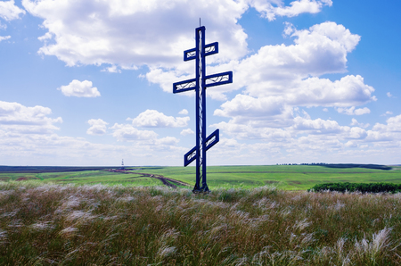 occurrence: Worship cross in the steppe. Drilling rig on the horizon