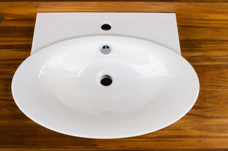 faience: Faience washbasin in a wooden tabletop Stock Photo