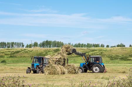 front loader: Loading hay front loader