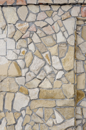 Fragment of the wall lined with stone