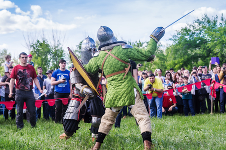swordfight: The swordfight heavily armed medieval warriors  The picture was taken in Russia, in Orenburg, at the