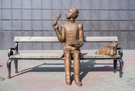 Sculpture of Pushkin sitting on the bench  The picture was taken in Russia, in the Orenburg region, in Orsk, near the wall of the building of the Drama Theater. 07022017 Editorial