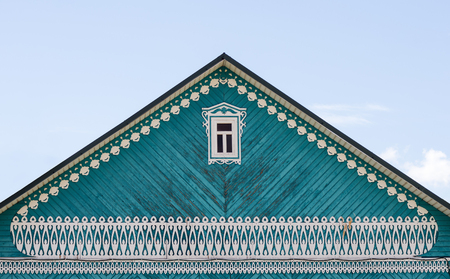 Pediment of a wooden house with carved decoration  Photo taken in Russia, in the city of Orenburg