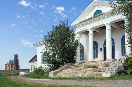 Portico with pillars of an old house  Photo taken in Russia, in the Orenburg region, in the village of Tugustemir. House of Culture, former landowners mansion. 07182017