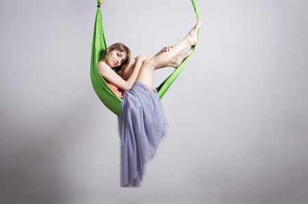 Girl in a hammock for yoga  Photo taken at a fitness club in Orenburg, Russia Stock Photo