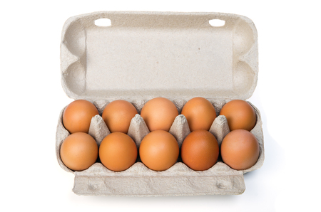 Dozen chicken eggs in a cardboard container. Isolated on white background Banque d'images