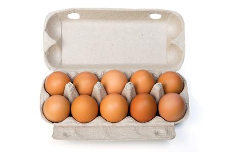 Dozen chicken eggs in a cardboard container. Isolated on white background Archivio Fotografico