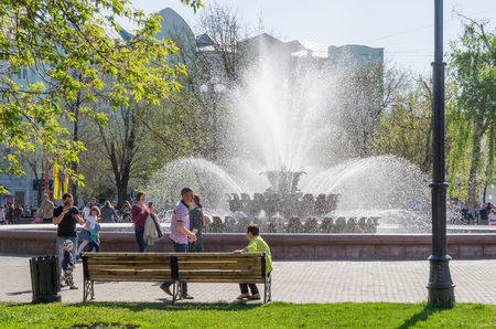 Orenburg, Russia-09 may, 2018:The townspeople having a rest near the fountain.