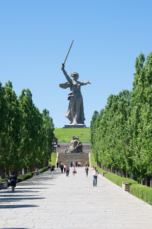 Volgograd, Russia - June 7, 2018: Alley of Pyromidal poplars and monuments