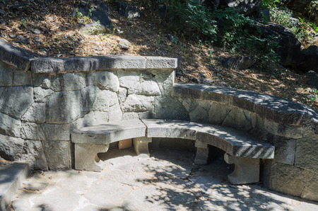 Russia, the Republic of Crimea, the city of Alupka. 06092018: Stone bench in the Vorontsov park 版權商用圖片