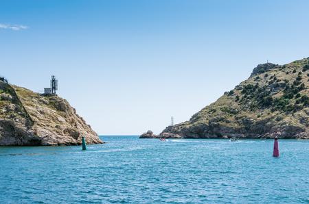 Seascape with coastal cliffs. Russia, Republic of Crimea, Balaclava. 11.06.2018: Exit to the open sea from the Balaklava bay