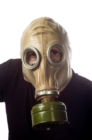 A man in a gas mask GP-5. Man in black t-shirt and gas mask close up. Isolated on white background Stock Photo