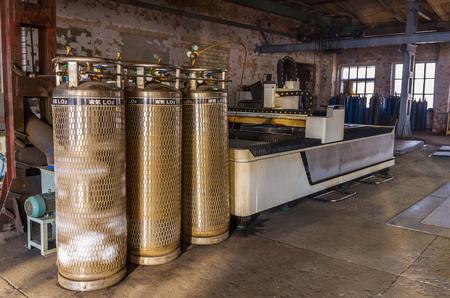 Laser cutting machine. Orenburg, Russia - March, 28, 2019: Laser machine for cutting sheet metal in factory premises Foto de archivo