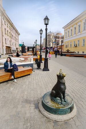 Monument to homeless animals. Orenburg, Russia - April, 2, 2019: Crossroads of Sovetskaya and Leninskaya streets. Monument money box in the form of a statue of a dog Editöryel
