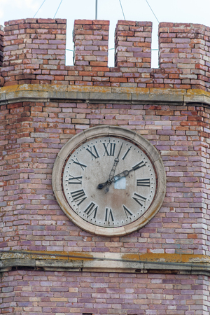 Tower clock. Orenburg, Russia - April, 06, 2019: The clock on the tower of the museum of the History of Orenburg, the former guardhouse