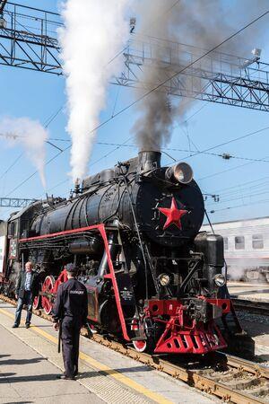 Steam locomotive Series L on the station platform. Orenburg, Russia - May, 8, 2019: Departure of the festive retro train from the Orenburg station Sajtókép