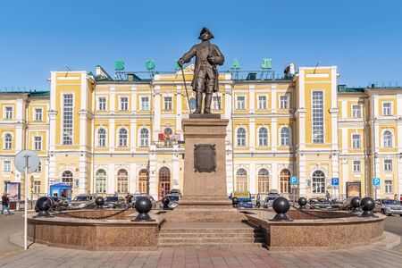 Monument to Rychkov, Peter Ivanovich. Orenburg, Russia - May, 8, 2019: Rychkov Monument on Railway Station Square in the background of the facade of the old railway station building Sajtókép